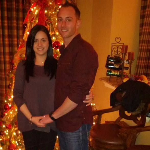 Gina Levtov and her husband by the Christmas tree