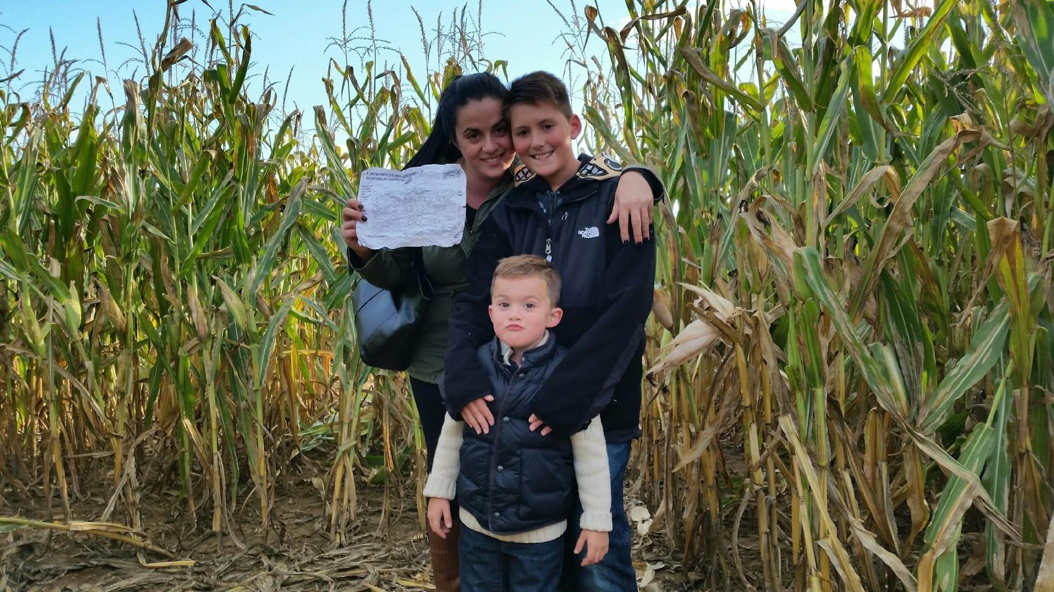 Gina Levtov and her sons complete a corn maze
